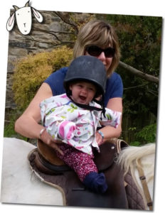 Baby enjoying a pony ride at Higher Lank Farm Family friendly holidays