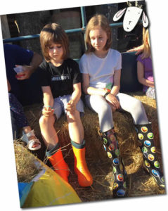 Older children enjoying the tractor and trailer ride at Higher Lank Farm Family friendly holidays